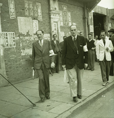 Jewish men with armbands outside of a building,Shanghai, China