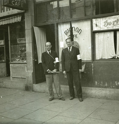 Jewish men wearing armbands in front of MiononCafe on East Seward Road, Shanghai, China