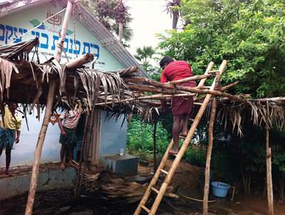 Building a sukkah at Bnei Yaakov Synagogue