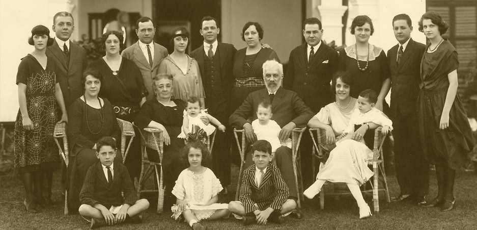 Frankel Estate, Singapore, 1923(From left) FIRST ROW: Julian Frankel, Tila Storch, Victor Clumeck, Ada Frankel, David Frankel, Becky Frankel, Julian Israel, Annetta Clumeck, Max Lewis, Thelma Clumeck;SECOND ROW: Marie Clumeck, Rosa Frankel with Serena Frankel on lap, Abraham Frankel with Joyce Clumeck on lap, Anna Frankel with David Frankel on lapTHIRD ROW: Lionel Clumeck, Anita Frankel, Jack Clumeck