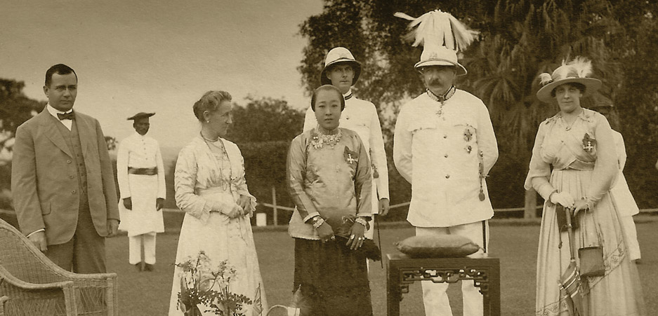 Marie Clumeck being awarded the MBE at the end of WWI by the British Governor, Singapore, 1918