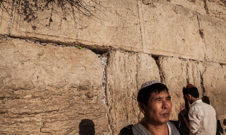 Jin Guangzhong stands before the Western Wall, Jerusalem. He travels to visit his elder daughter almost every year.